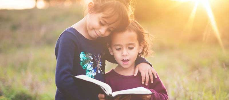 foster siblings reading book