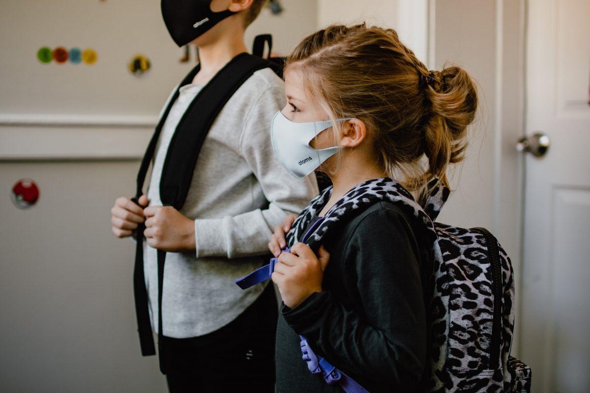 Children in masks going to school.