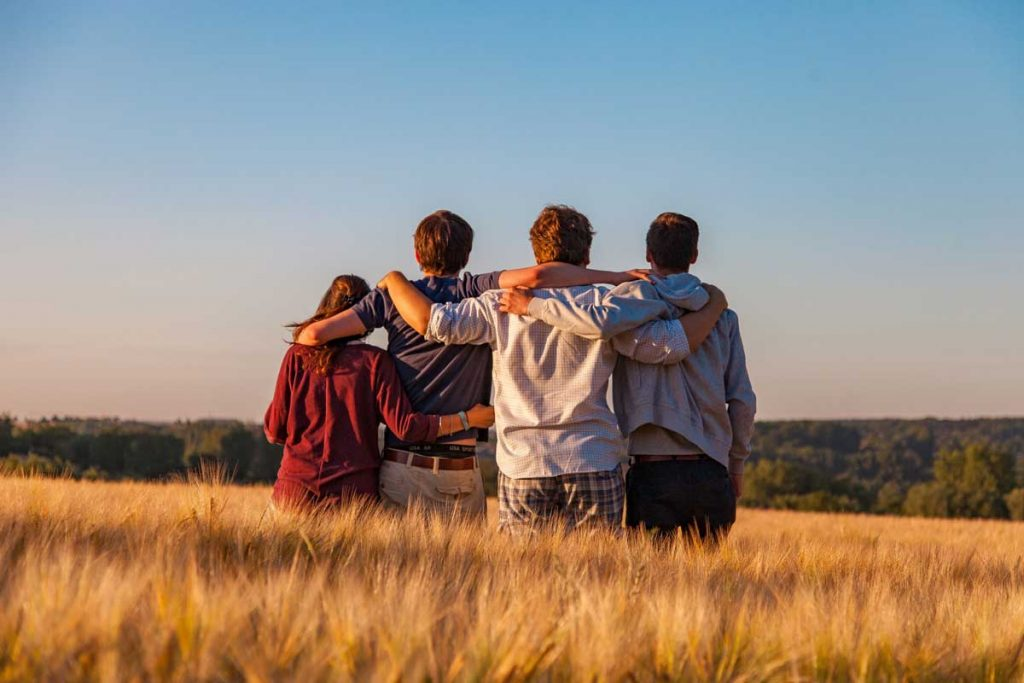 Kids outside overlooking a field.